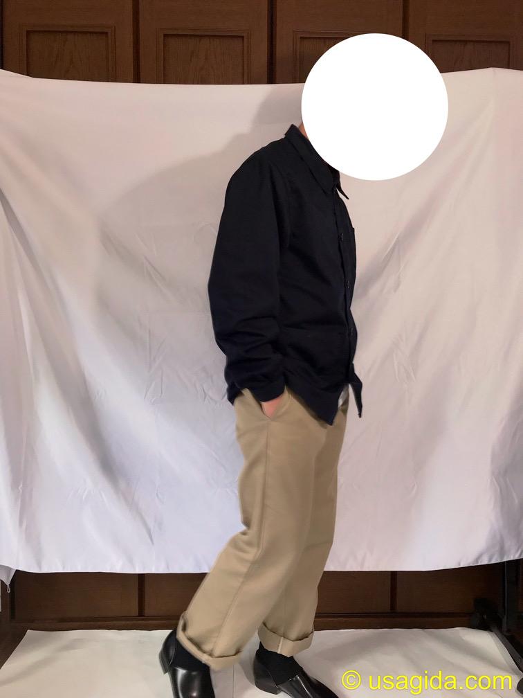 ユナイテッドアスレのカバーオールを着た人